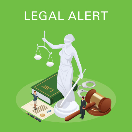 Legal alert law book, gavel, handcuffs, and statue