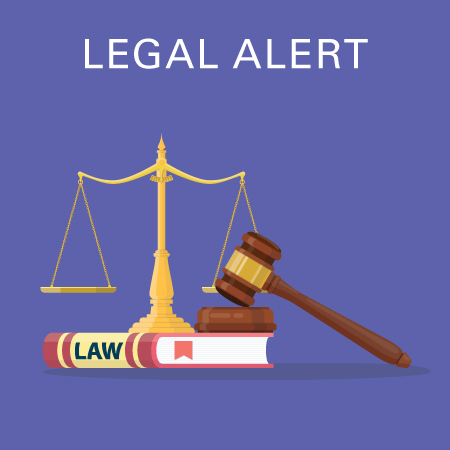Legal alert law book, gavel, and balance